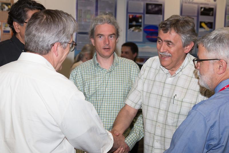 "Demos Kazanas shakes hands with Tuck, with John Baker (center) -- Retirement party for Robin ""Tuck"" Stebbins, NASA/GSFC, May 20, 2016"