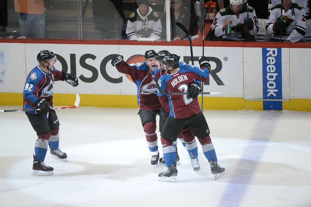 . Gabriel Landeskog (92) Paul Stastny (26), Nathan MacKinnon (29) and Nick Holden (2) of the Colorado Avalanche celebrate MacKinnon\'s goal during the first period of action. The Colorado Avalanche hosted the Minnesota Wild in the first round of the Stanley Cup Playoffs at the Pepsi Center in Denver, Colorado on Saturday, April 19, 2014. (Photo by Karl Gehring/The Denver Post)
