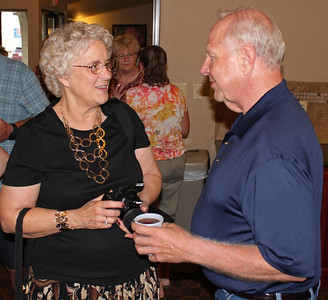 Peggy (Shaw) Bays chats with Larry Trout.