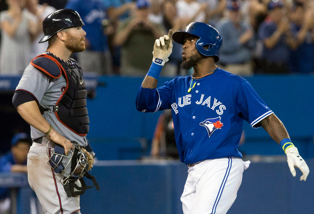 . Toronto\'s Jose Reyes, right, gestures in front of Twins catcher Ryan Doumit while crossing the plate after his a solo shot to left off Minnesota starter Scott Diamond during the fifth inning. (AP Photo/The Canadian Press, Chris Young)