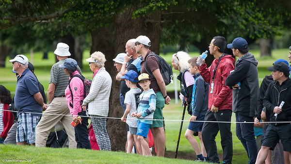 Fans (mostly) watching the action on the final day of the Asia-Pacific Amateur Championship tournament 2017 held at Royal Wellington Golf Club, in Heretaunga, Upper Hutt, New Zealand from 26 - 29 October 2017. Copyright John Mathews 2017.   www.megasportmedia.co.nz