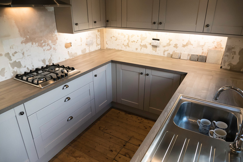Completed kitchen awaiting tiling, decoration and flooring by others.
