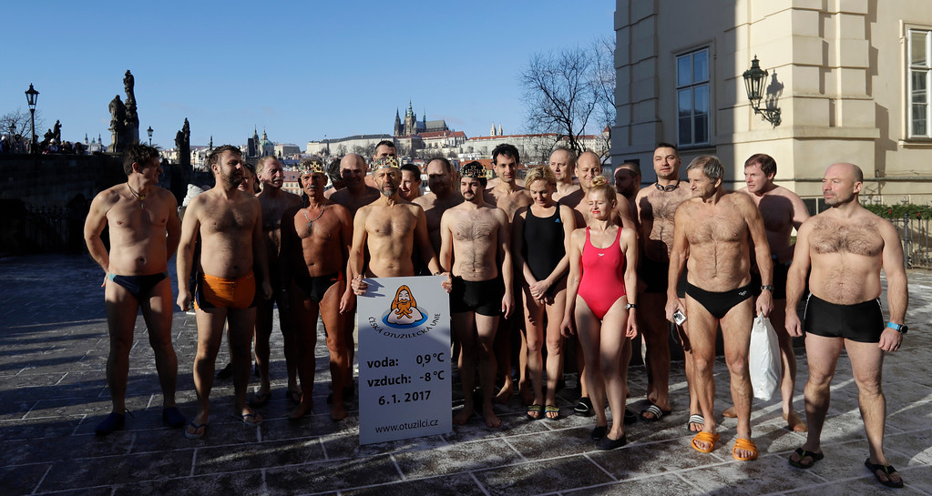 . Polar swimmers line up before the traditional Three Kings swim in the Vltava River in Prague, Czech Republic, Friday, Jan. 6, 2017. The Prague castle is in the background. (AP Photo/Petr David Josek)