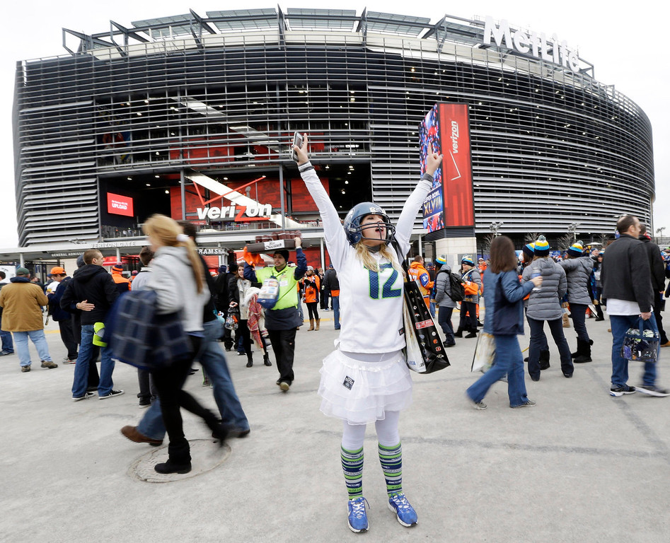 . Lacey Surprenat of Seattle cheers outside MetLife Stadium before the NFL Super Bowl XLVIII football game Sunday, Feb. 2, 2014, in East Rutherford, N.J. (AP Photo/Julio Cortez)