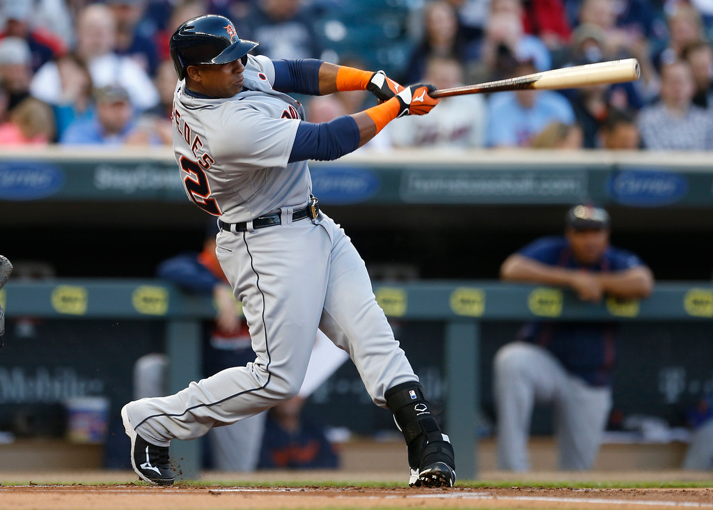 . Detroit Tigers� Yoenis Cespedes connects with a three-run home run off Minnesota Twins pitcher Tommy Milone in the first inning of a baseball game, Monday, April 27, 2015, in Minneapolis. (AP Photo/Jim Mone)