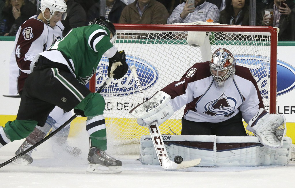 . Colorado Avalanche goalie Semyon Varlamov (1) blocks a a shot against Dallas Stars left wing Antoine Roussel (21) during the first period of an NHL hockey game Tuesday, Feb. 3, 2015, in Dallas. At left is Avalanche defenseman Tyson Barrie (4)  (AP Photo/LM Otero)