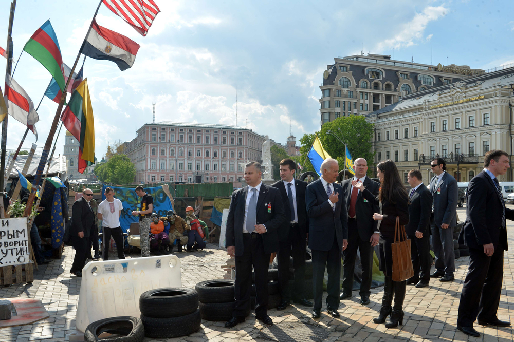 """. US Vice President Joe Biden (6th R) stands at one of barricades of Maidan anti-government protesters during his visit in Kiev on April 22, 2014. US Vice President Joe Biden on Tuesday accused Russia of \""""trying to pull Ukraine apart\"""" and pledged Washington\'s strong support for Kiev\'s leaders, as a Cold War-style confrontation over the former Soviet republic ratcheted up. Biden was speaking in Kiev amid worrying signs on the ground that diplomacy was failing to calm the crisis. (SERGEI SUPINSKY/AFP/Getty Images"""