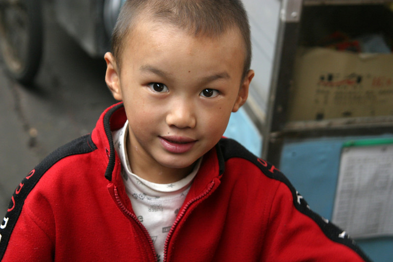 Xian station little boy Qinghai -Beijing to Tibet Railway, Beijing to Lhasa  Oct  2006