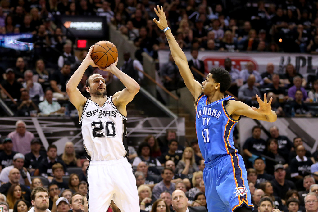 . Manu Ginobili #20 of the San Antonio Spurs shoots over Jeremy Lamb #11 of the Oklahoma City Thunder in the first half in Game One of the Western Conference Finals during the 2014 NBA Playoffs at AT&T Center on May 19, 2014 in San Antonio, Texas.  (Photo by Ronald Martinez/Getty Images)