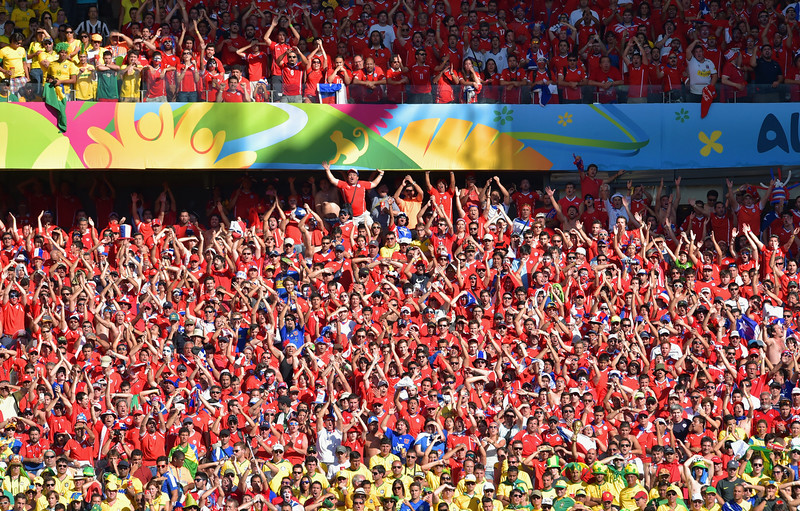 . Fans cheer during the 2014 FIFA World Cup Brazil round of 16 match between Brazil and Chile at Estadio Mineirao on June 28, 2014 in Belo Horizonte, Brazil.  (Photo by Buda Mendes/Getty Images)