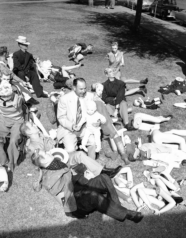 . Hillman Lee, manager of a department store, is surrounded by mannequins and mannequin parts which endured an atomic blast while in the basement bomb shelter of house number one at the Nevada proving grounds near Las Vegas, Nev., March 17, 1953.. Most of the mannequins are battered and show evidence of their experience. They were brought back to Las Vegas after the test. (AP Photo)