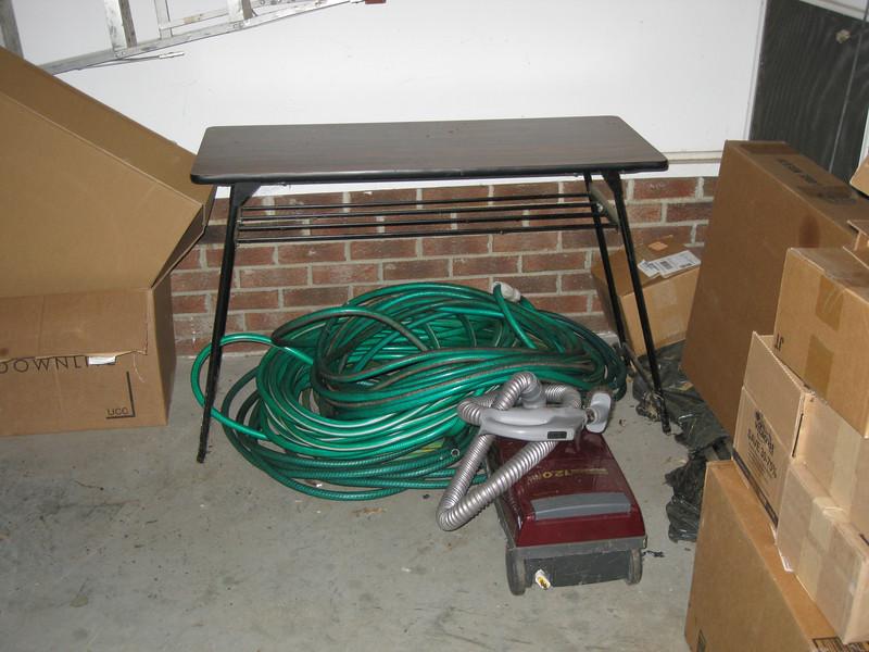 Patio table, hoses.