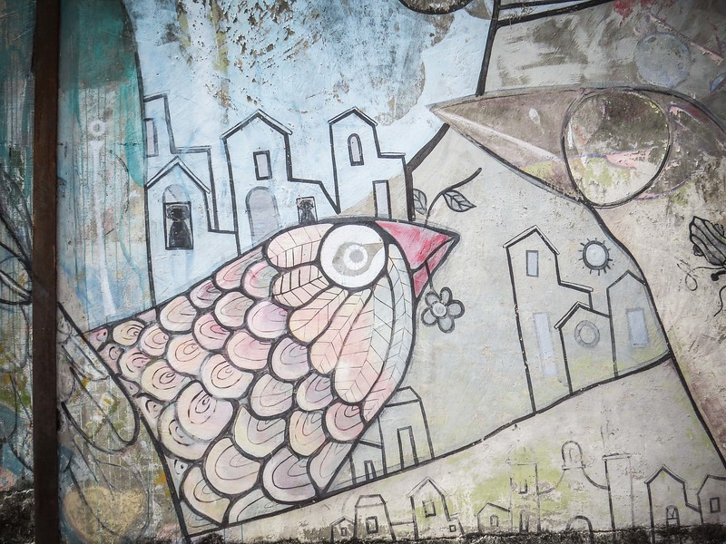 I love this large mural of a bird with a flower in it's beak.