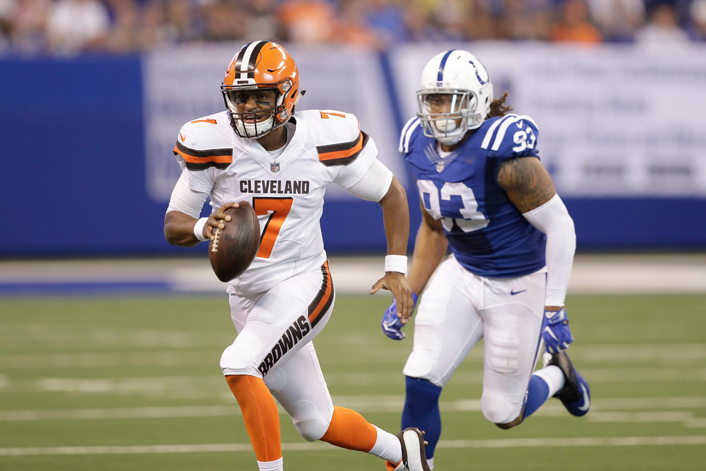 . Cleveland Browns quarterback DeShone Kizer (7) runs in front of Indianapolis Colts outside linebacker Jabaal Sheard (93) during the first half of an NFL football game in Indianapolis, Sunday, Sept. 24, 2017. (AP Photo/Darron Cummings)