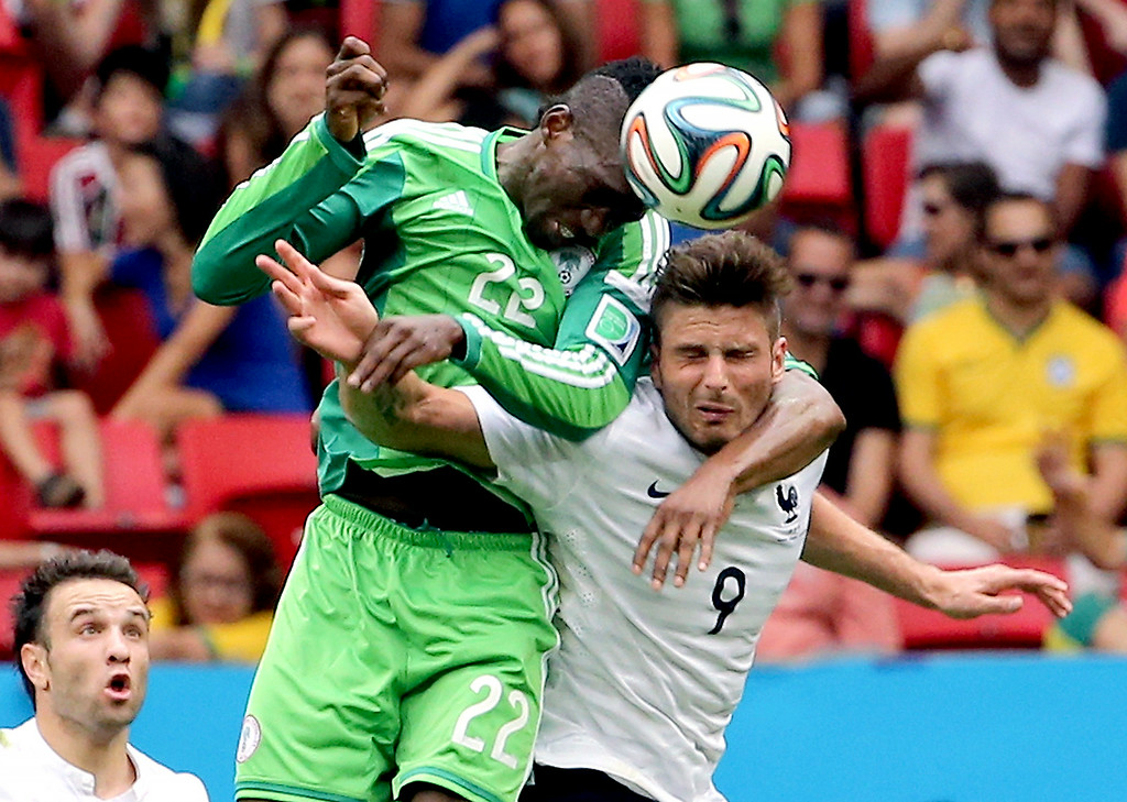 . Nigeria\'s Kenneth Omeruo (22) battles for the ball with France\'s Olivier Giroud (9) during the World Cup round of 16 soccer match between France and Nigeria at the Estadio Nacional in Brasilia, Brazil, Monday, June 30, 2014. (AP Photo/David Vincent)