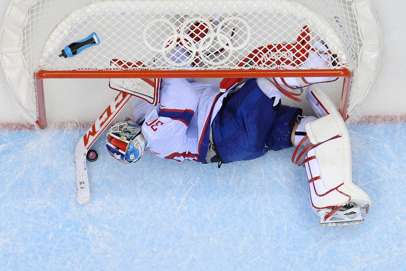 . Norway\'s goalkeeper Lars Haugen fails to stop a goal from Russia\'s Ilya Kovalchuk (not seen) during the Men\'s Ice Hockey play-offs qualification match Russia vs Norway at the Bolshoy Ice Dome during the Sochi Winter Olympics on February 18, 2014.  (ALEXANDER NEMENOV/AFP/Getty Images)
