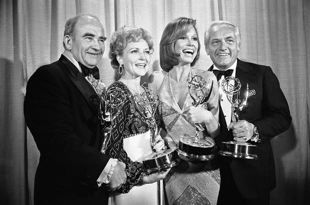 ". Members of the ?Mary Tyler Moore Show? pose with their Emmys backstage, Monday, May 18, 1976 at the 28th annual Emmy Awards in Los Angeles. From left are, Ed Asner, who plays the news director on the show but won his Emmy for his role in ?Rich Man Poor Man""; Betty White, supporting actress; Ms. Moore for best actress in a comedy show and Ted Knight for supporting actor. (AP Photo/Reed Saxon)"