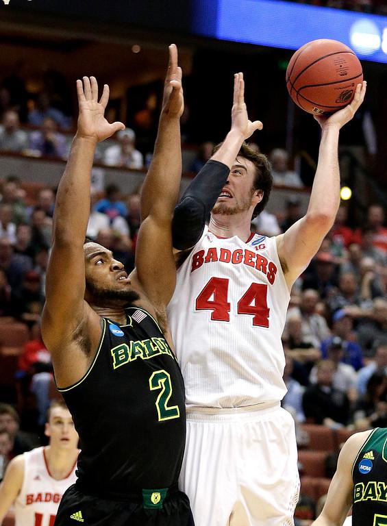 . Wisconsin forward Frank Kaminsky (44) shoots over Baylor forward Rico Gathers (2) during an NCAA men\'s college basketball tournament regional semifinal, Thursday, March 27, 2014, in Anaheim, Calif. (AP Photo/Jae C. Hong)