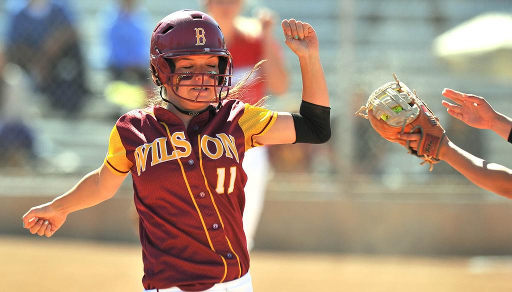 . LONG BEACH - 04/09/2013  (Photo: Scott Varley, Los Angeles Newspaper Group)  Lakewood vs Wilson girls softball at Joe Rodgers Field. Wilson batter Kori Cochran is thrown out at 1B.