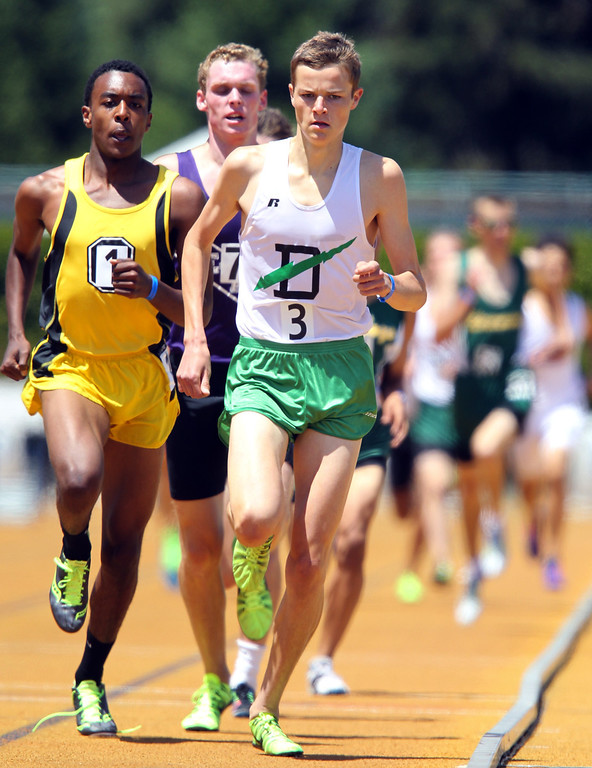 . Sir Francis Drake\'s Clayton Hutchins, right, leads Bishop O\'Dowd\'s Eugene Hamilton III, left, and Petaluma\'s Ryan Douglas, center, during the boys 1600 meter final at the North Coast Section Meet of Champions at Cal\'s Edwards Stadium in Berkeley, Calif., on Saturday, May 25, 2013. Hutchins placed second in the race. (Anda Chu/Bay Area News Group)