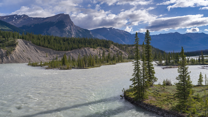 River with mountains in the background, Saskatchewan River Crossing, Icefields Parkway, Jasper, Alberta, Canada