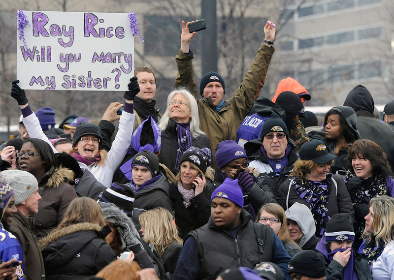 . Baltimore Ravens fans cheer during a send-off rally for the team on Monday, Jan. 28, 2013 in Baltimore. The NFL football team is leaving for New Orleans to face the San Francisco 49ers in the Super Bowl. (AP Photo/Steve Ruark)
