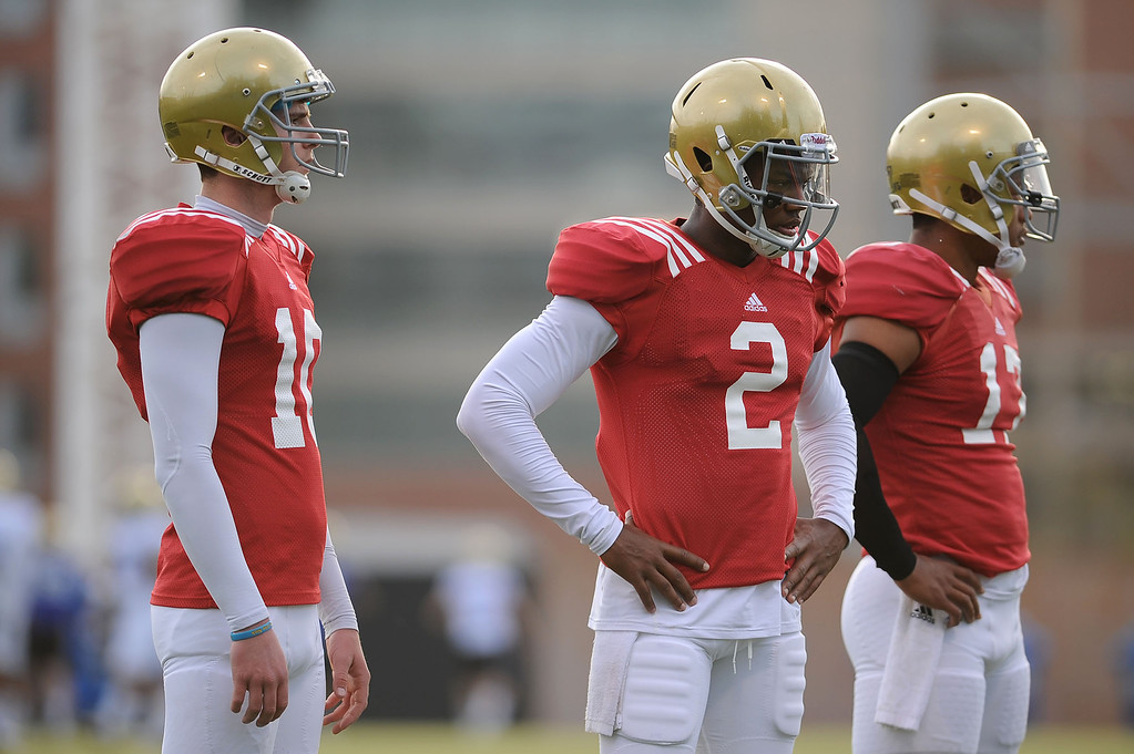 . UCLA quarterbacks Jake Hall, Asiantii Woulard and Brett Hundley (l-r) look on during practice April 9, 2014 in Westwood, CA.(Andy Holzman/Los Angeles Daily News)