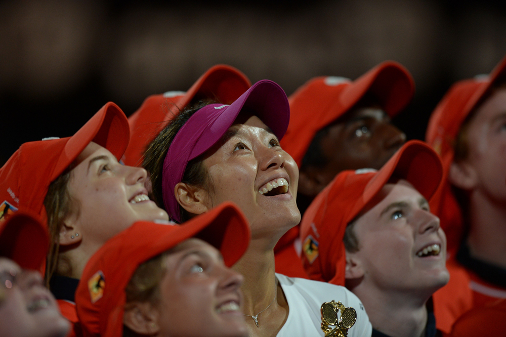 . China\'s Li Na (C) poses with ballboys as she celebrates after victory in her women\'s singles final match against Slovakia\'s Dominika Cibulkova on day thirteen of the 2014 Australian Open tennis tournament in Melbourne on January 25, 2014. (GREG WOOD/AFP/Getty Images)