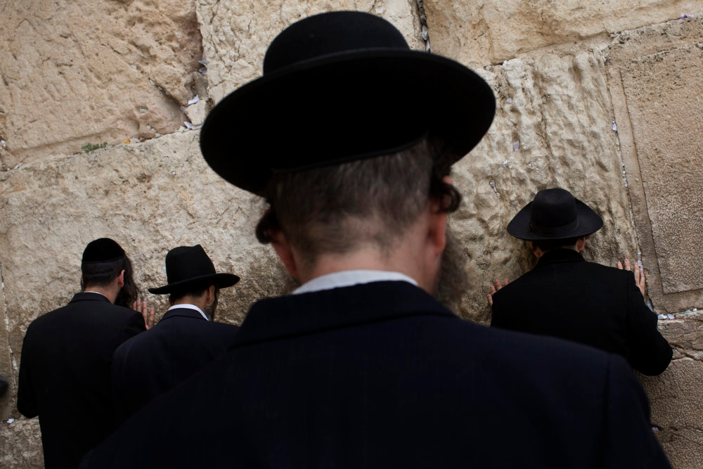 . Ultra-orthodox Jewish men pray at the Western Wall, the holiest site where Jews can pray, in Jerusalem\'s Old City, Tuesday, April 16, 2013. Israel is celebrating its annual Independence Day, marking 65 years since the founding of the state in 1948. (AP Photo/Bernat Armangue)