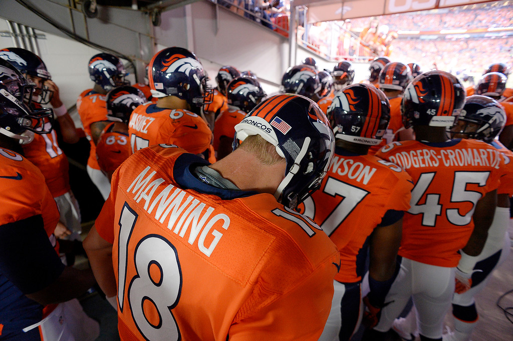 . Denver Broncos quarterback Peyton Manning (18) waits to take the field before the Broncos\' game agains the Baltimore Ravens. A lightning delay postponed the start of the game by about 30 minutes. (Photo by John Leyba/The Denver Post)