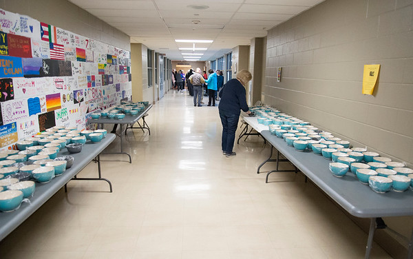01/30/20 Wesley Bunnell | StaffrrThe annual SOUPerBowl to benefit the Friendship Centers Soup Kitchen took place on Thursday Jan 30, 2020 at E.C. Goodwin Technical School. Bowls line the hallway leading to the cafeteria.