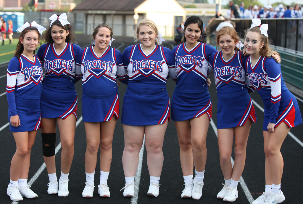 . Randy Meyers - The Morning Journal<br> The Bay varsity cheerleaders pose for a photo prior to Thursday\'s game aginst Parma.
