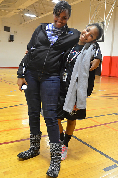 Candice Hayes and Tamara Wood take a break after watching their friends play basketball.