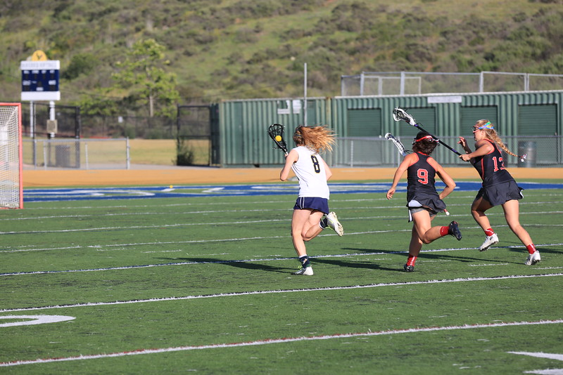 2015_03_31 Girls Lacrosse LCC 15 vs Santa Ana Mater Dei 11 0187.JPG