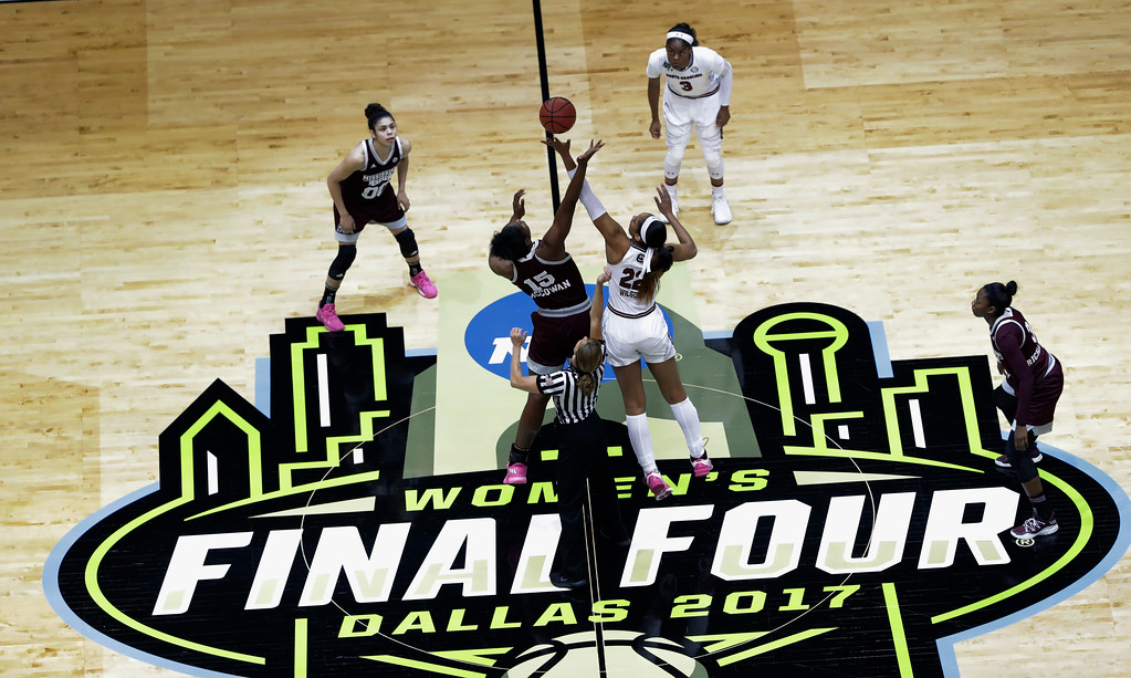 . Mississippi State center Teaira McCowan (15) and South Carolina forward A\'ja Wilson (22) reach for the ball on the opening tipoff of the final of the NCAA women\'s college basketball tournament Final Four, Sunday, April 2, 2017, in Dallas. (AP Photo/Eric Gay)