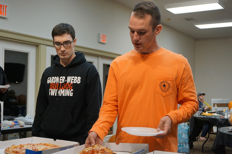 Dalton Meyers and Josh Walston chat as they get pizza.