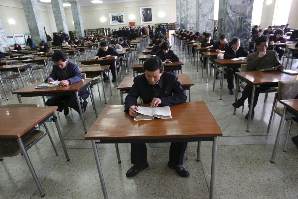 Description of . North Koreans read at desks inside a room of the People's Study House, a public library in Pyongyang, North Korea on Tuesday, Feb. 26, 2008.  (AP Photo/David Guttenfelder)