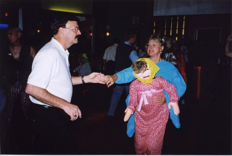 "Bruce dancing with the  ""back packing"" doll"