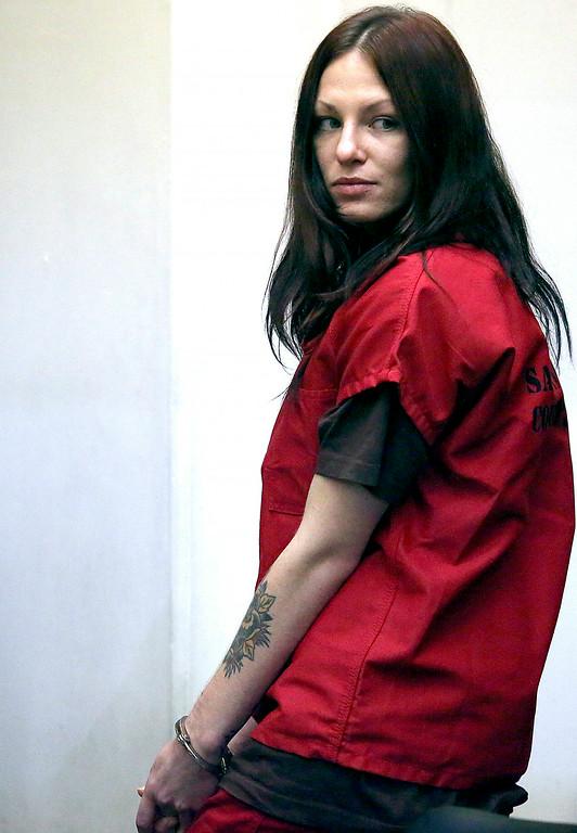 . Alix Tichelman looks back toward her family in Department 3 of Santa Cruz County Superior Court as she leaves her arraignment on Wednesday. (Shmuel Thaler � Santa Cruz Sentinel)