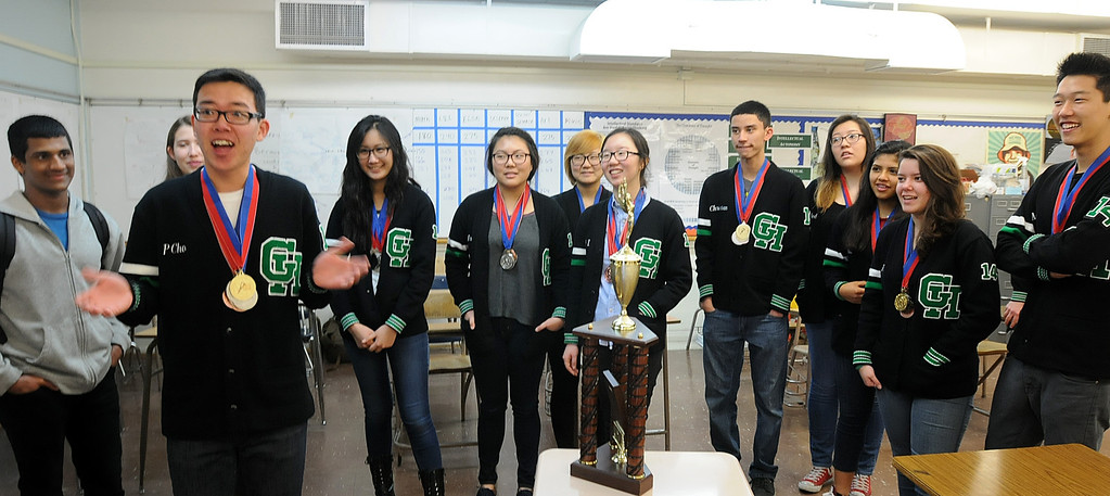 . The Granada Hills Charter High School Academic Decathlon team took second place in the California State Decathlon competition in Sacramento.  El Camino Real Charter High School finished first.  Both teams will travel to Hawaii for the National competition.  Peter Cho, left, and members of the team reflect on the weekend back in their classrom on Monday, March 24, 2014.  (Photo by Dean Musgrove/Los Angeles Daily News)