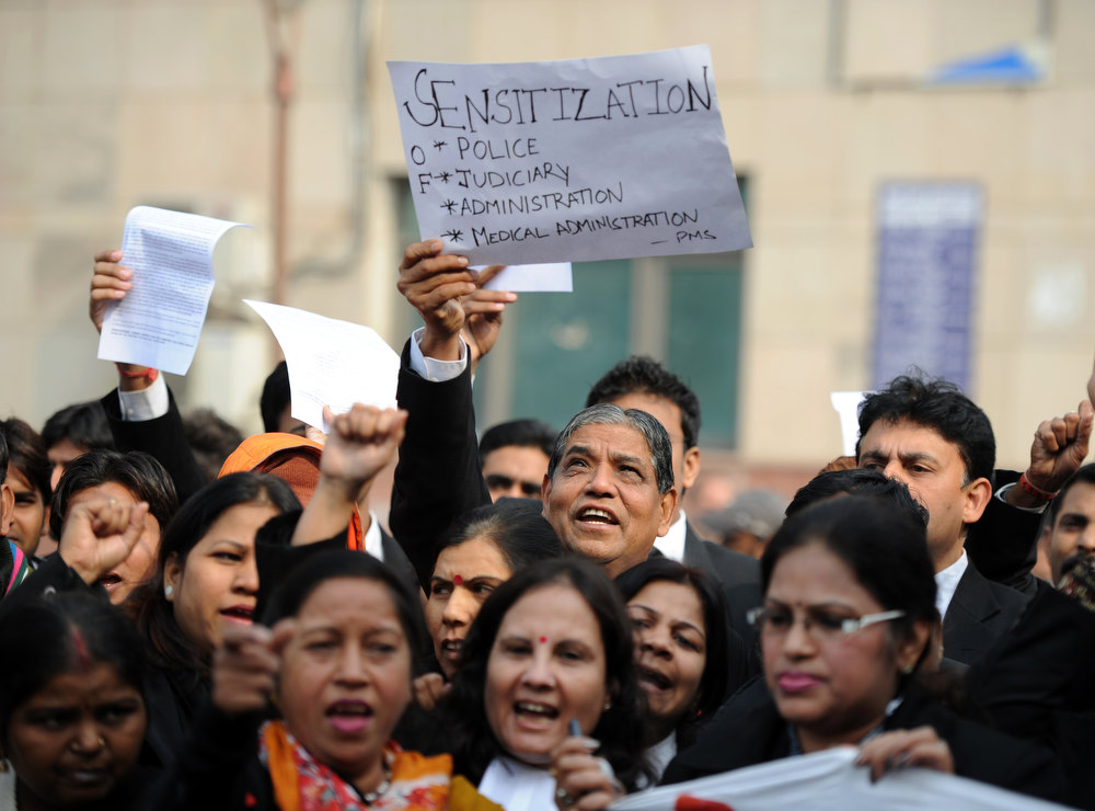 Description of . Indian lawyers shout slogans as they hold placards during a protest at the entrance to Saket District Court in New Delhi on January 3, 2013. A gang of men accused of repeatedly raping a 23-year-old student on a moving bus in New Delhi in a deadly crime that repulsed the nation are to appear in court for the first time. Police are to formally charge five suspects with rape, kidnapping and murder after the woman died at the weekend from the horrific injuries inflicted on her during an ordeal that has galvanised disgust over rising sex crimes in India  SAJJAD HUSSAIN/AFP/Getty Images