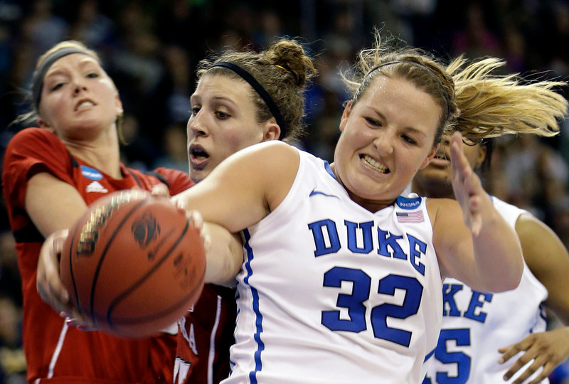 . Duke guard Tricia Liston (32) struggles with Nebraska forward Jordan Hooper , center,  and Nebraska forward Emily Cady, left, during the second half of a regional semifinal game of the women\'s NCAA college basketball tournament Sunday, March 31, 2013, in Norfolk, Va. Duke won 53-45. (AP Photo/Steve Helber)