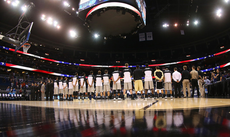 . The Colorado Buffaloes stand during the national anthem before taking on the Pittsburgh Panthers during the second round of the 2014 NCAA Men\'s Basketball Tournament at Amway Center on March 20, 2014 in Orlando, Florida.  (Photo by Mike Ehrmann/Getty Images)