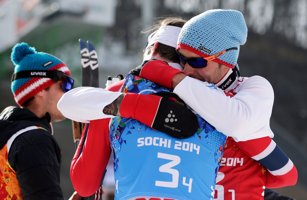 . Austria\'s Magnus Hovdal Moan, Haavard Klemetsen, Magnus Krog and Joergen Graabak celebrate winning the gold after the cross-country portion of the Nordic combined Gundersen large hill team competition at the 2014 Winter Olympics, Thursday, Feb. 20, 2014, in Krasnaya Polyana, Russia. (AP Photo/Matthias Schrader)