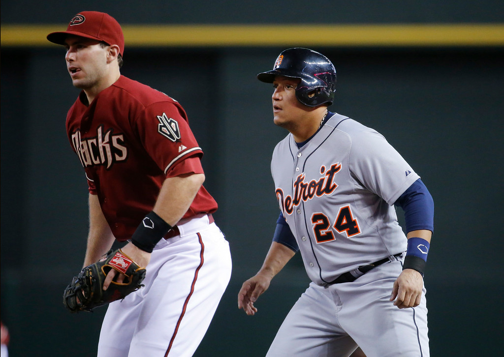 . Detroit Tigers\' Miguel Cabrera (24) and Arizona Diamondbacks\' Paul Goldschmidt watch a pitch during the fourth inning of a baseball game, Wednesday, July 23, 2014, in Phoenix. (AP Photo/Matt York)
