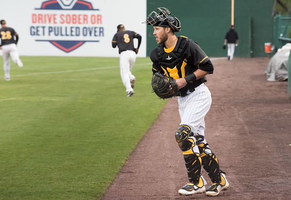 05/03/19 Wesley Bunnell | Staff The New Britain Bees home opener vs the Somerset Patriots on Friday night at New Britain Stadium. Bees catcher Logan Moore (30) takes the field.