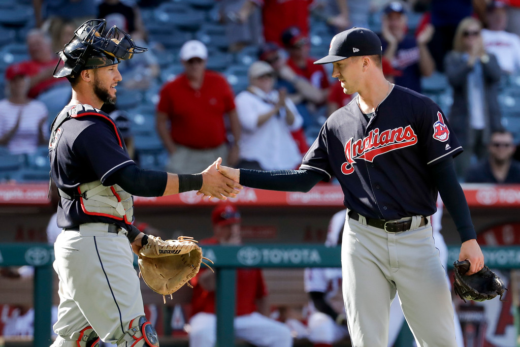 . Cleveland Indians catcher Yan Gomes, left, celebrates with relief pitcher Tyler Olson after their win against the Los Angeles Angels during a baseball game in Anaheim, Calif., Thursday, Sept. 21, 2017. (AP Photo/Chris Carlson)