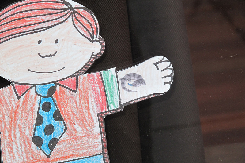 Flat Stanley's new (temporary) tattoo of a blue-tongued skink.
