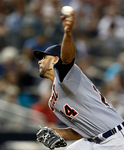 . Detroit Tigers starting pitcher David Price delivers in the fourth inning of a baseball game against the New York Yankees at Yankee Stadium in New York, Tuesday, Aug. 5, 2014.  (AP Photo/Kathy Willens)