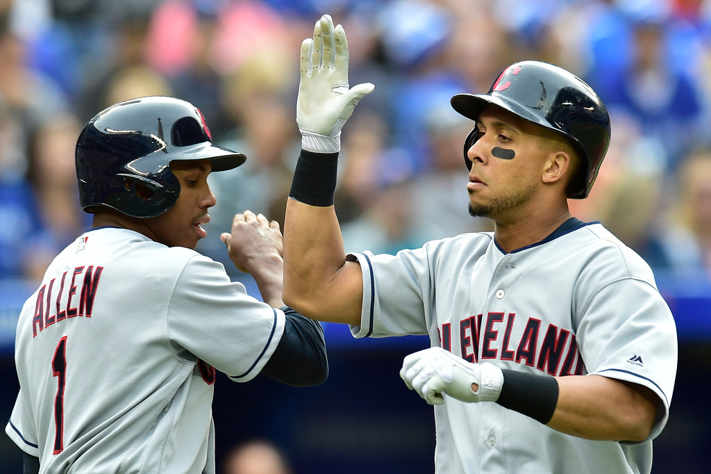. Cleveland Indians Michael Brantley, right, celebrates with Greg Allen after hitting a two-run home run in the fifth inning of a baseball game against the Toronto Blue Jays in Toronto, Saturday, Sept .8, 2018. (Frank Gunn/The Canadian Press via AP)
